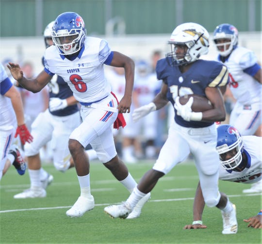 Cooper defensive back Isaiah Boutte (6) chases a Keller ball carrier during the Cougars' season opener at Keller.