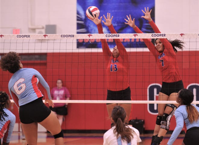 Cooper's Jennika Willis (13) and Diamond Brown (7) try to block a shot by Wichita Falls Hirschi's Auhneja Brandon (6). Cooper beat the Lady Huskies 25-12 25-18, 25-21 in the nondistrict match Tuesday, Sept. 17, 2019, at Cougar Gym.
