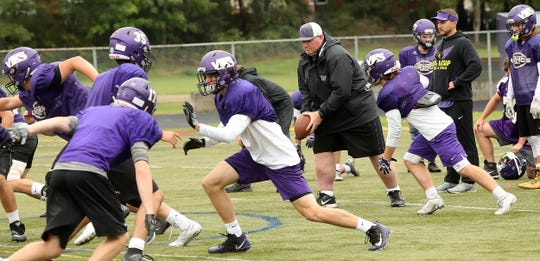 North Kitsap head coach Jeff Weible runs his team through offensive plays during practice on Tuesday, September 17, 2019.