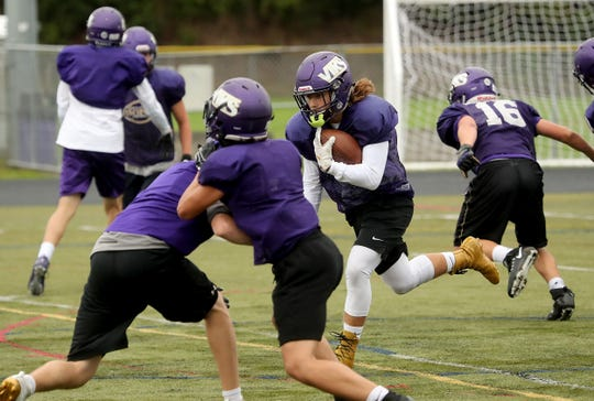 North Kitsap running back Josh Fisher carries the ball during practice on Tuesday, September 17, 2019.