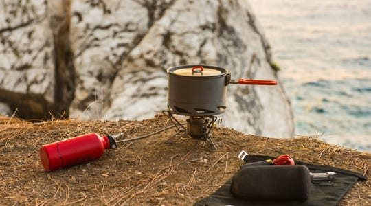 A camp stove and plenty of propane bottles can mean hot meals if a storm knocks out the power.