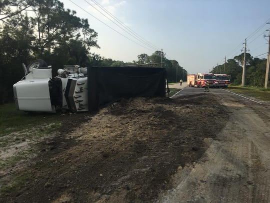 A dump truck turned over on Adamson Road in Cocoa after a crash spilling sand and fuel across the roadway.