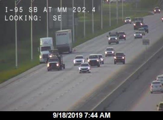 A tractor trailer's breaks caught fire disrupting traffic along I 95 north in Cocoa on Monday, Sept. 18, 2019.