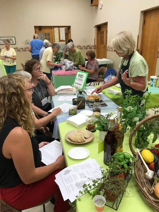 During the Earth, Wind and Flowers  Garden Club's recent  guest night, Mary Ann Basinger shared a segment on cooking with herbs.