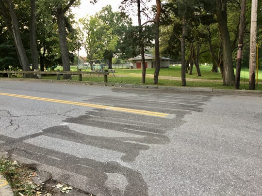 The remnants of a crosswalk that was removed by the Burlington Department of Public Works on Locust Street near Calahan Park in Burlington. Photographed Wednesday morning, Sept. 18, 2019.