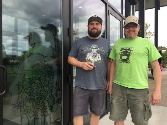 Shane Rumrill and Joel Hartman, employees at The Alchemist, stand outside the Stowe brewery on Sept. 17, 2019.