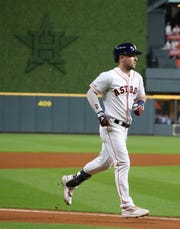 Sep 17, 2019; Houston, TX, USA; Houston Astros third baseman Alex Bregman (2) rounds the bases after hitting a home run against the Texas Rangers in the sixth inning at Minute Maid Park. Mandatory Credit: Thomas B. Shea-USA TODAY Sports