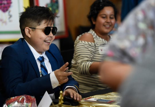 Twelve-year-old Osman Mendoza prepares to sign an autograph at Driscoll Children's Hospital holiday cards unveiling, Wednesday, Sept. 18, 2019. Mendoza, from Laredo, Texas, wants to be a YouTuber when he grows up.