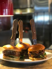 A signature burger at Laughing Fox Tavern will feature 8-ounce chuck with a chipotle barbecue sauce, white cheddar, applewood smoked bacon on a brioche bun