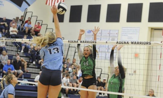 Huntington's Allison Basye and Katie Hirsch go to block a ball during a 3-1 loss to Adena at Adena High School in Frankfort, Ohio on Tuesday September 17, 2019.