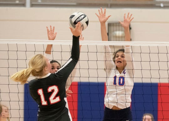 Zane Trace's Emily Allen goes to block a ball during a 3-0 loss to Westfall at Zane Trace High School.