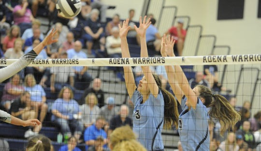 Adena's Jenna Martin and Makenna Lovely go to block a ball during a 3-1 win over Huntington at Adena High School in Frankfort, Ohio on Tuesday September 17, 2019.