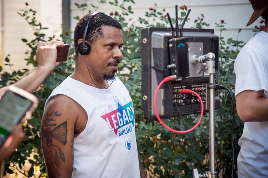 "Filmmaker Ya'Ke Smith, this year's Duncanson Artist-in-Residence at the Taft Museum of Art, is seen here on the set of his latest project, ""Brother."" He will make several appearances in Greater Cincinnati in October, screening films and discussing his career."