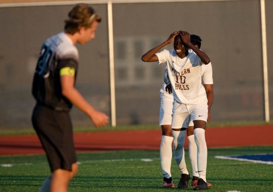 Western Hills' Issiaka Thiama (10) reacts to missing a shot during the OHSAA soccer matcher between Western Hills High School and West Clermont County High School on Tuesday, Sept. 17, 2019, at West Clermont County High School.