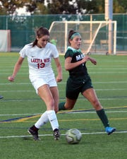 Lakota West forward Kailyn Dudukovich scores on this kick while defended by Mason's Megan Rubsam.
