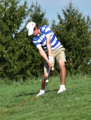 Zach Brinks of St. Xavier pitches out of the high rough while battling in the GCL Quad Golf match at TPC River's Bend Golf Course, September 17, 2019