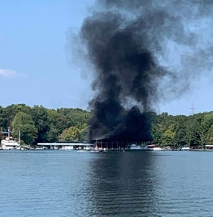 Smoke pours from Leatherwood Marina after a fire on Sunday, Sept. 15, 2019.