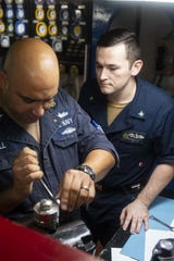 Engineman 1st Class Thomas Gill, of Lambertville, left, and Machinist's Mate 3rd Class Brandon Amodeo, of Boston, perform maintenance on a pressure regulator in an emergency diesel generator room aboard the aircraft carrier USS Dwight D. Eisenhower (CVN 69). Ike, with embarked Carrier Air Wing 3, is underway conducting the Tailored Ship's Training Availability (TSTA) and Final Evaluation Problem (FEP) as part of the basic phase of the Optimized Fleet Response Plan.