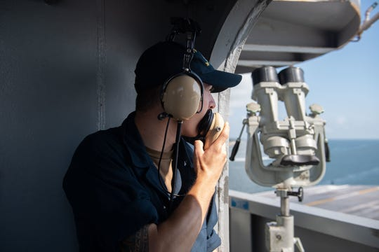 U.S. Navy Operations Specialist Seaman David Dabrowski, from South Bound Brook, stands watch on vulture's row aboard the aircraft carrier USS John C. Stennis (CVN 74) as the ship departs Norfolk, Virginia, Sept. 16, 2019. The John C. Stennis is underway conducting routine operations in support of Commander, Naval Air Force Atlantic.
