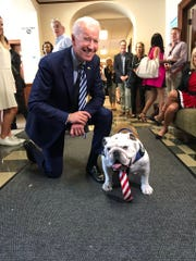 Drake University's live mascot Griff meets presidential candidate Joe Biden while making a campaign visit to the Drake campus in Des Moines.
