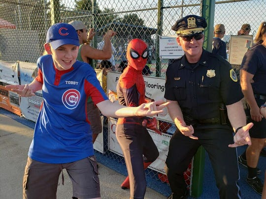 Tobby Givler and his buddy Police Chief Dana Wingert on Tuesday night's game.
