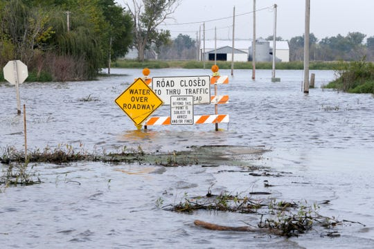 Rising flood waters from the Missouri River cover a road in Honey Creek, Iowa, Wednesday, Sept. 18, 2019. The Iowa Department of Transportation warned drivers that if the river continues to rise they might have to close a portion of Interstate 29 north of Council Bluffs.