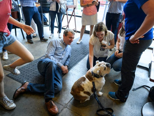 U.S. Sen.Michael Bennet, D-Colo., 2020 democratic presidential candidate, and his family 19-year-old Caroline, 18-year-old Halina, 15-year-old Anne and wife Susan Daggett meet Drake University mascot Griff during a small campaign event at Mars Cafe in Des Moines, Iowa, Sunday morning, Aug. 11, 2019.