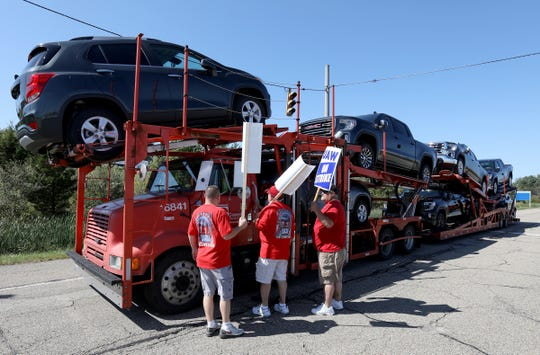 UAW members stop to talk with car transports traveling down Hallock-Young Road in front of the empty Lordstown plant that were moving GM cars made in Mexico  in front of their house in Lordstown, Ohio on Wednesday, September 18, 2019.