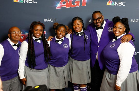 """Members of the Detroit Youth Choir and the group's director, Anthony White, second from right, posed for a photo on on Sept. 17, 2019, the day of the season finale performance show for """"America's Got Talent."""""""