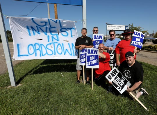 (L to R) Pat Musolino, Jeff Austin, Dan Santangelo, Mike Yakim, Jason Markovich and Darren Bodak in front of the sign they created in front of the Lordstown Assembly where the Chevy Cruze was made until the plant was closed March.