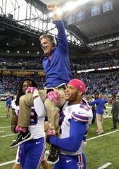 Jim Schwartz, defensive coordinator for the Buffalo Bills, is carried off the field after the 17-14 win over the Lions at Ford Field, Oct. 5, 2014.