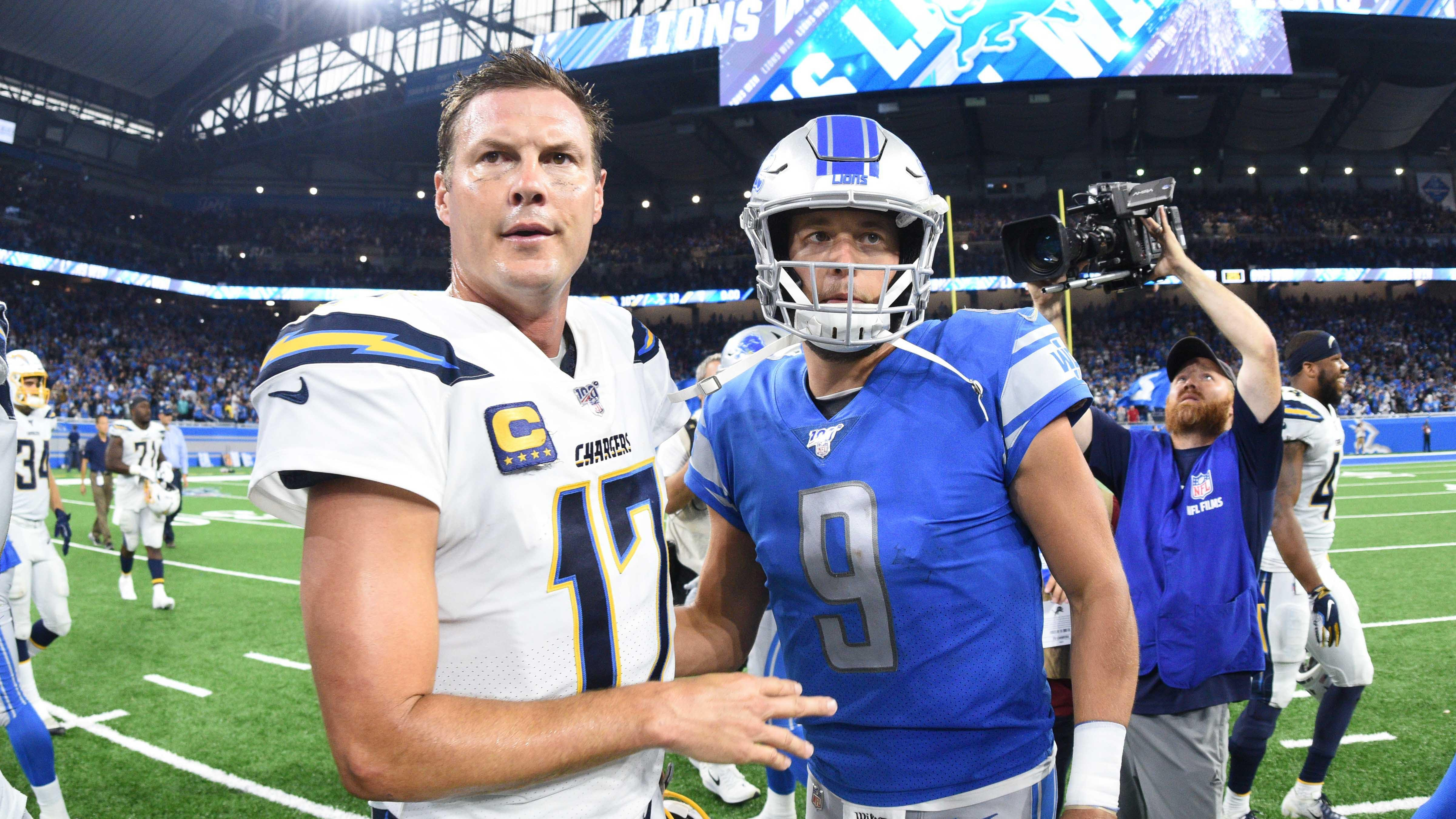 Los Angeles Chargers quarterback Philip Rivers and Detroit Lions quarterback Matthew Stafford meet after the Lions' 13-10 win at Ford Field, Sept. 15, 2019.