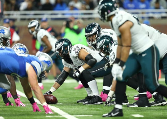 Philadelphia Eagles center Jason Kelce prepares to snap the ball against the Detroit Lions during the second half at Ford Field, Oct. 9, 2016.