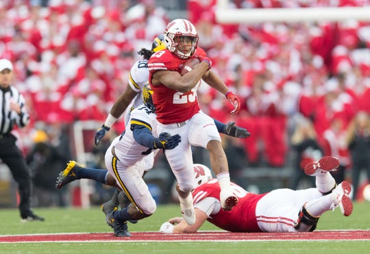 Wisconsin's Jonathan Taylor runs against Michigan on Nov. 18, 2017 in Madison, Wis.
