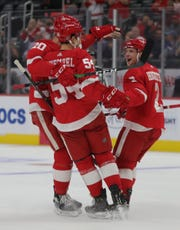 Detroit Red Wings left wing Matt Puempel (54) celebrates his goal with center Christoffer Ehn (70) and defenseman Joe Hicketts (2) during first period action Tuesday September 17, 2019 at Little Caesars Arena in Detroit.