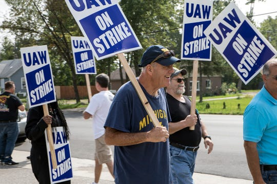 "James Toor, 67, a tool-maker and 48 1/2 year GM employee from Garden City, pickets in support of younger GM workers with the UAW outside Romulus Powertrain in Romulus, Mich., Tuesday, Sept. 17, 2019.  ""I've got everything I need.  These young people need support. Some have been here 5 years without being hired in,"" he said."