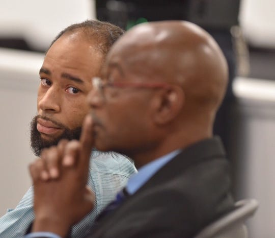 Pierre Cleveland, left, sits with his defense attorney, Emmett Greenwood, during his preliminary exam in front of 36th District Court Judge Michael Wagner, Wednesday afternoon, Sept. 18, 2019