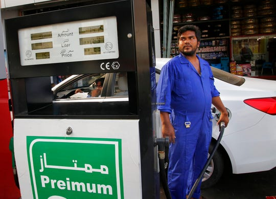 A worker refuels a car at a gas station in Jiddah, Saudi Arabia, Tuesday, Sept. 17, 2019.