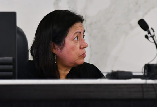 Magistrate Laura Echartea of the 36th District Court reads the four counts of murder charges against defendant Deangelo Martin at his arraignment Wednesday  in Detroit.