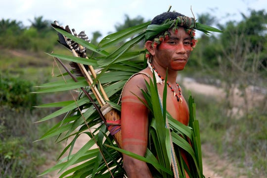 Indigenous Tembe warrior Ronilson Tembe poses for a portrait on the Alto Rio Guama indigenous reserve as he waits for police to arrive with other members of his tribe in Para state, Brazil, Wednesday, Sept. 4, 2019.