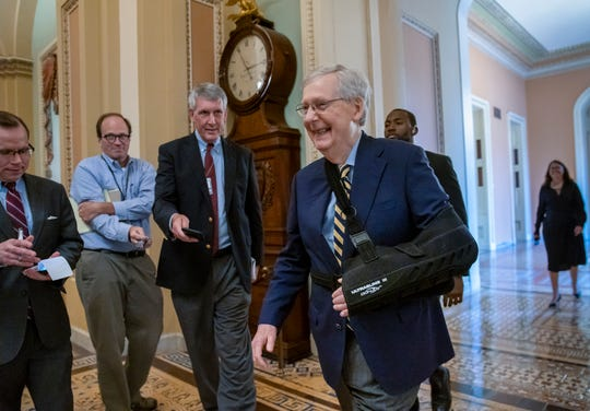 Senate Majority Leader Mitch McConnell, R-Ky., walks past reporters to the Senate chamber with his arm in a sling after he suffered a broken shoulder in a fall at his home during the August recess, at the Capitol in Washington, Monday, Sept. 9, 2019.