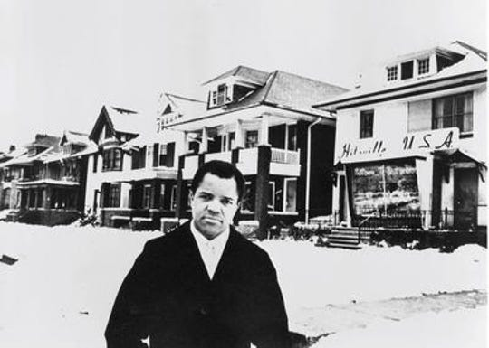 Berry Gordy Jr. stands in front of Motown's Hitsville USA studio in Detroit.