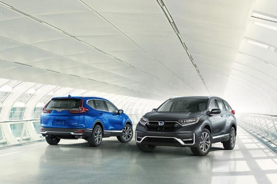 The 2020 Honda CR-V, sporting freshened styling, new features and upgraded powertrains, and the new CR-V Hybrid.