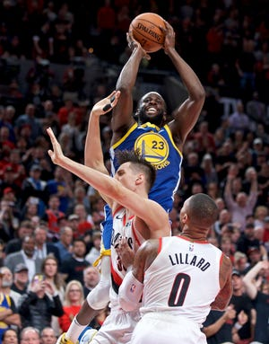 Golden State Warriors forward Draymond Green, top, earned a spot on Sports Illustrated's NBA All-Decade Second Team. Green is a Saginaw native who starred at Michigan State.