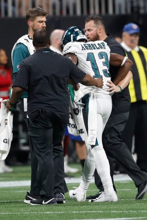 Eagles wide receiver Nelson Agholor (13) walks off the field after an injury Sunday night against the Atlanta Falcons.