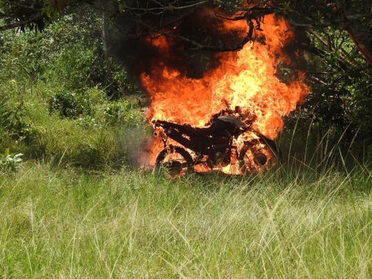 In this image courtesy of Wiririhu Tembe, a motorcycle that belonged to illegal loggers burns after it was set fire by Tembe indigenous people on the Alto Rio Guama indigenous reserve in Para state, Brazil, Tuesday, Aug. 27, 2019.