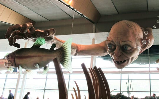 "in this Nov. 24, 2012, file photo, a giant sculpture of Gollum, a character from ""The Hobbit,"" is displayed in the Wellington Airport."