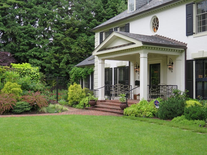 A lawn is among the features that make a house a home. It doesn't have to be perfect, although this front lawn comes pretty close. No matter what kind of lawn you grow or how much you mow, lawns are a part of life.