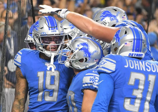 Lions teammates celebrate with Kenny Golladay after his go-ahead touchdown catch in the fourth quarter last Sunday against the Chargers.