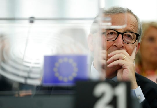 European Commission President Jean-Claude Juncker listens Wednesday, Sept. 18, 2019 in Strasbourg, eastern France, as members of the European Parliament discuss the current state of play of the UK's withdrawal from the EU.